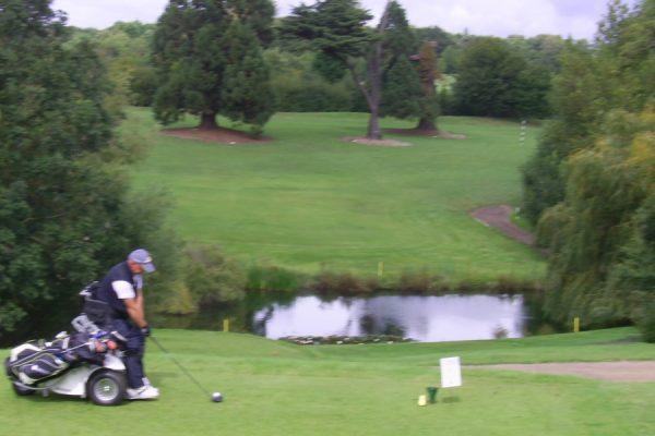 European Wheelchair Golf Champion Mark Gibson tees off